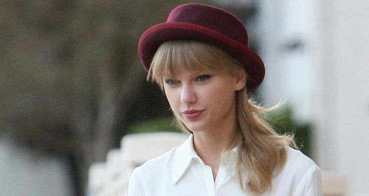 Taylor Swift wears dotted sheer black pantyhose -- ... read more on Tights.fun!