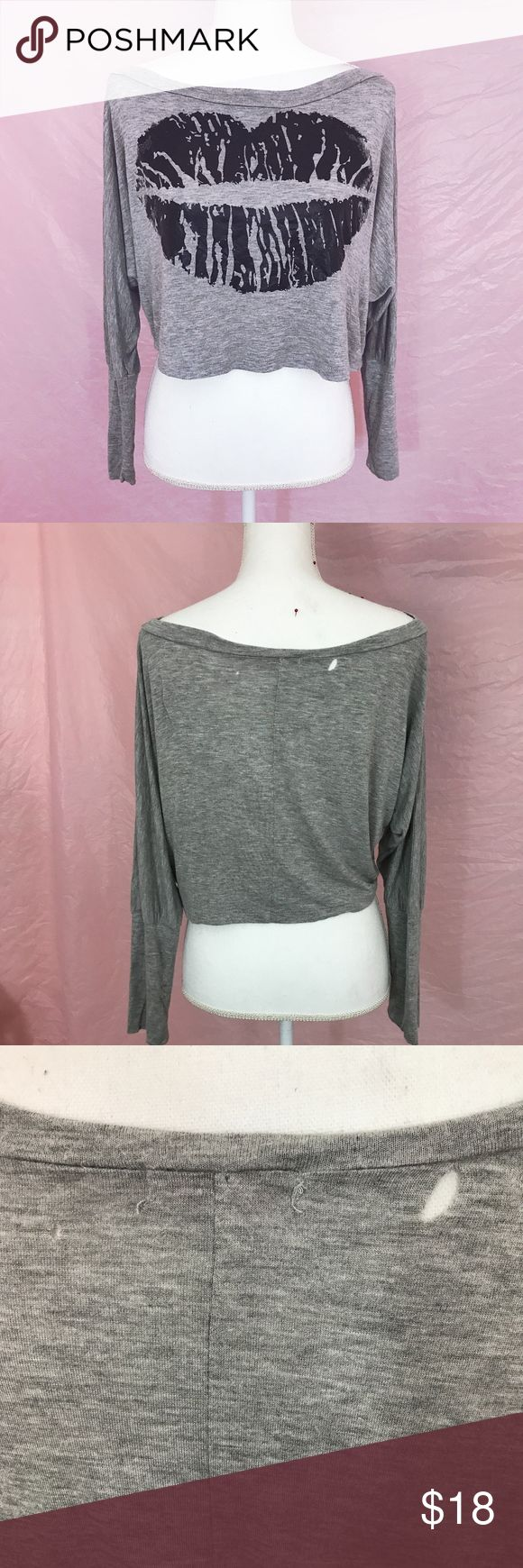 Lip Print Graphic Gray Long Sleeve Crop Top Super cute lip print crop top!  Perfect for lounging around, but so easy to dress up into a fun outfit!  Super soft gray material with shiny black lip print design.  Sleeves are loose but are more fitted from the elbows down.  No size tag, fits small-large.  Intentional loose fit.  Two tiny holes in the back near the top.  No staining.  Add your favorite listings to a bundle to receive a special discount! 💕 Body Central Tops Crop Tops