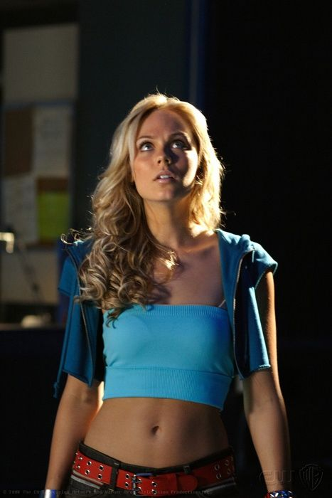 Laura Vandervoort.. (born Kara Zor-El) is Supergirl  ( Smallville )