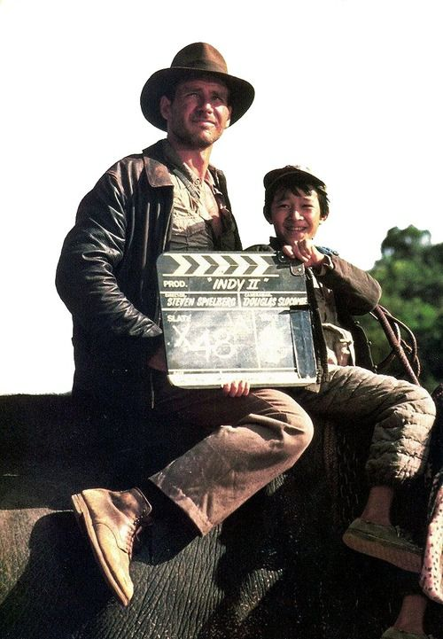 Harrison Ford and Jonathan Ke Quan on the set of Indiana Jones and the Temple of Doom (1984).