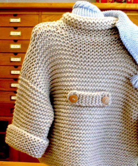detalle de la trabilla del abrigo corto de punto bobo