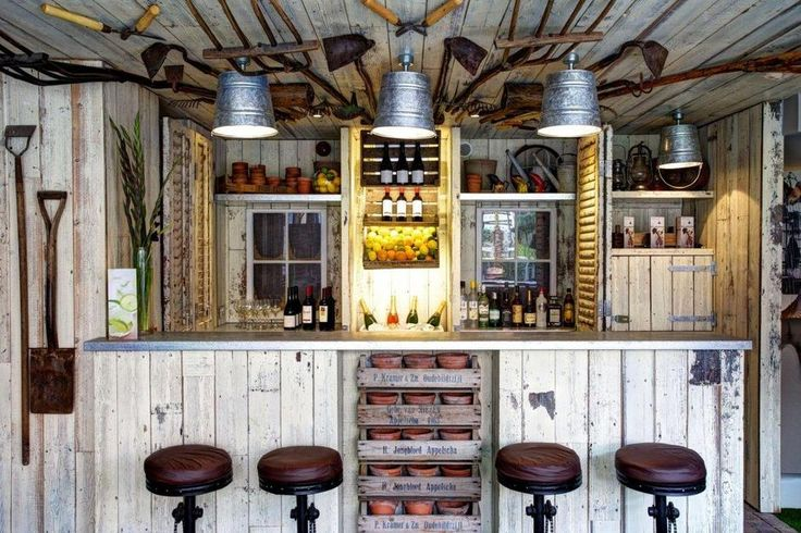 'The Potting Shed Bar' in The Garden Love love this. Sort multiple purpose with lots and shovels being used as decor and storage
