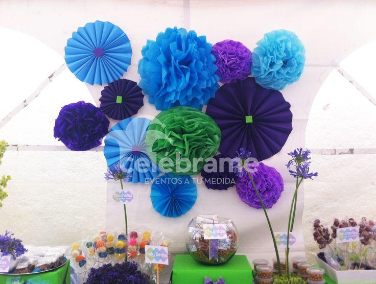 Mesa de dulces para XV años en colores morado, verde limón y azul. Pompones de papel / Candy and snack bar in purple, lime green and blue. Paper pompons  Facebook: Celébrame