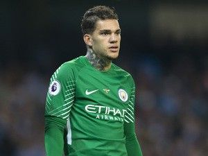Manchester City's Ederson trains after being stretchered off against Liverpool