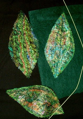 fabric-leaf These are made with scraps of yarn.. Make them with tiniest scraps of fabric?  Pieces are applied to stabilizer and backed with felt to make them more solid