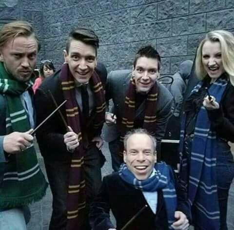 Tom Felton, the Phelps twins, Evanna Lynch, and Warwick Davis in their respective house scarves.
