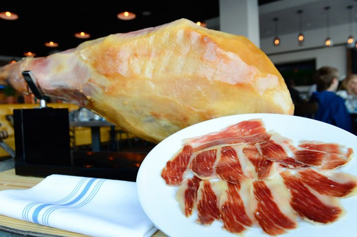 ...a Spanish tavern--not tapas--here slices of jamon pata negra are carved at tableside.