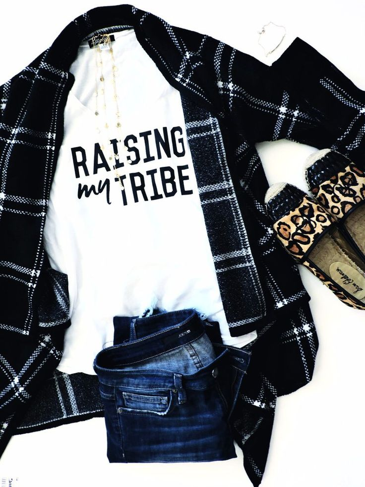 """Raising my Tribe"" ® Trademarked Fit: slim fitted. Slight relaxed fit on the body. Fabric weight 3.8 oz. Recommended to size up. The perfect slim fitted loose tee, cut with a rounded hem and open, rib"