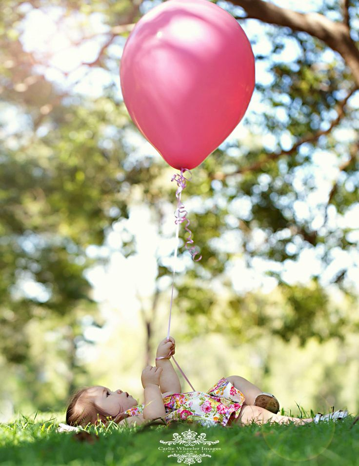 Posing for her photoshoot wearing Lacey Lane   First Birthday Cake Smash Outdoor Photoshoot