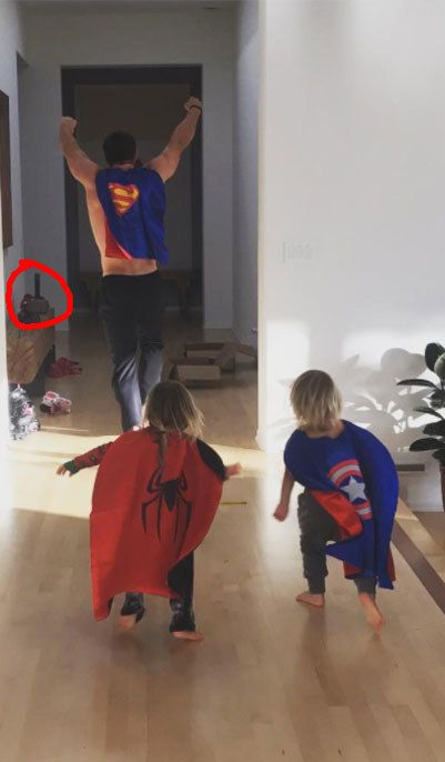 Yes, that is shirtless Thor, dressed as with his twin sons Captain America and Spider-Man. With Mjölnir just chilling in the background.