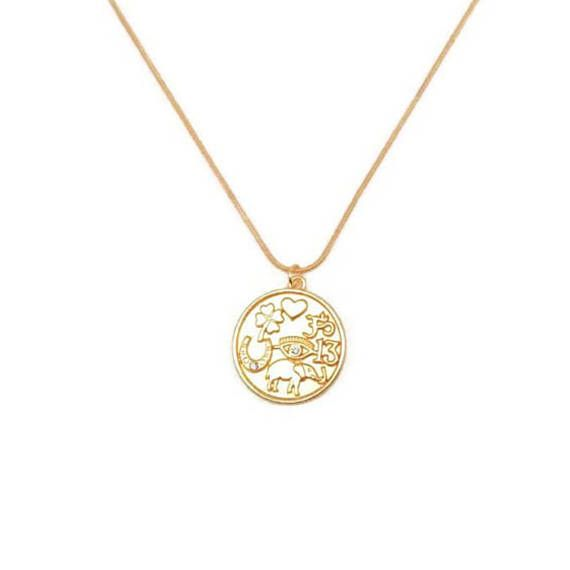 This gold coin necklace will be your new good luck charm because its got all the bases covered: evil eye embedded with a mini crystal, a four-leaf clover, lucky elephant jewelry, horseshoe, heart, om yoga symbol, and lucky number 13. -Bring on good vibes with our new lucky gold