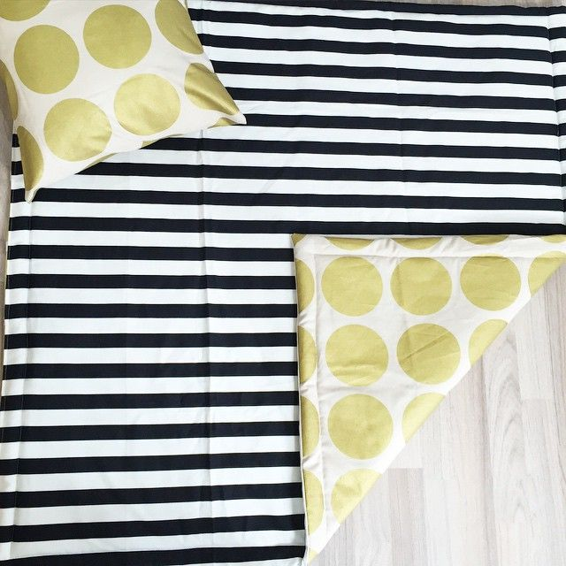 A close-up of the reversible play mat & cushion to celebrate the arrival of Baby Nixon from NZ! His nursery is monochrome with splashes of gold. We can custom make any of our products to create the ultimate, personal gift!