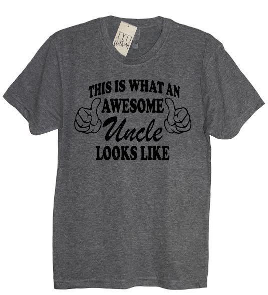 "Show people what an awesome Uncle looks like! A heather gray men's very soft and comfortable tee with black ""This Is What An Awesome Uncle Looks Like"" print. Available in crew neck or v neck. Printed on 50% polyester/25% ring-spun combed cotton/25% rayon, 32 singles, 4.3 ounce tri-blend.Tri-blend fabric provides superior fit and comfort. Set-in collar of 1x1 baby rib knit.  *Please reference our men's t-shirt size chart for approximate dimensions."