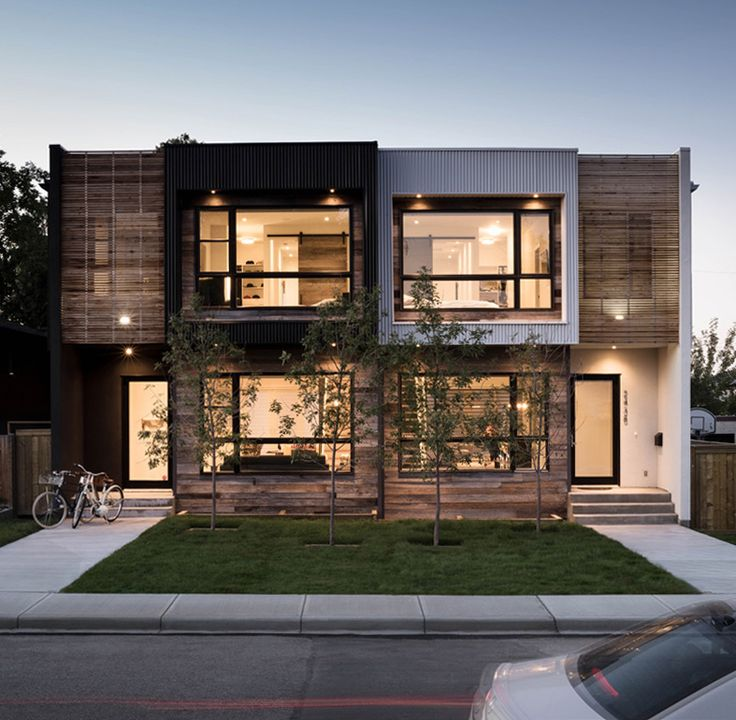 Two new homes that feature a variety of natural and for Townhouse architecture designs