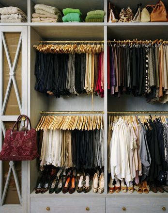 Organized closet ~ Annie Schlecter Photography: Chic organized walk-in closet with gray cabinets & drawers, shoe rack and bag rack.
