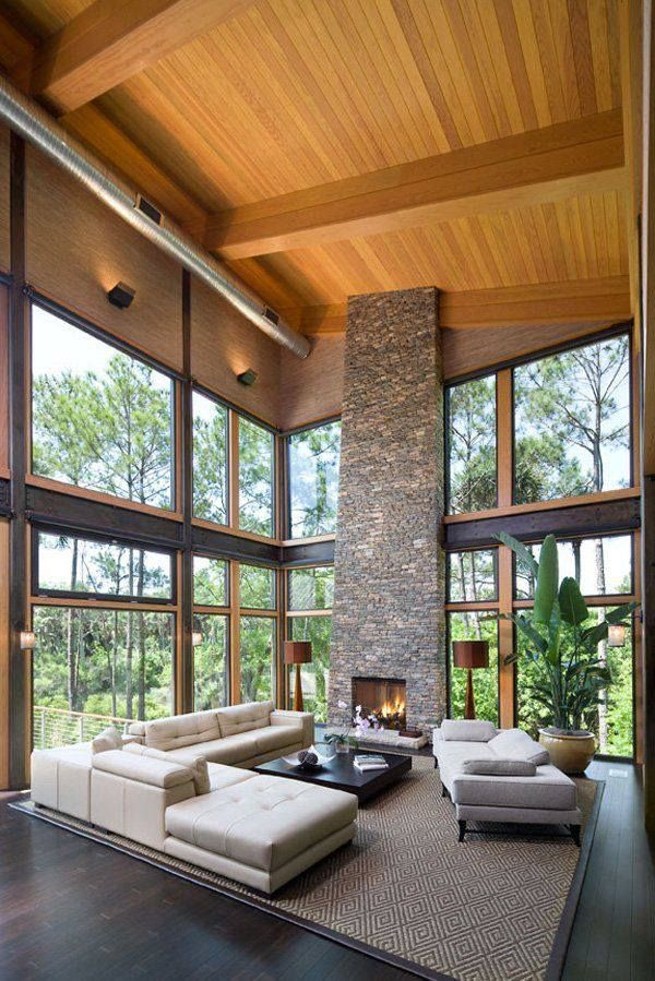 Love the high ceilings and stone fireplace, exposed timber.