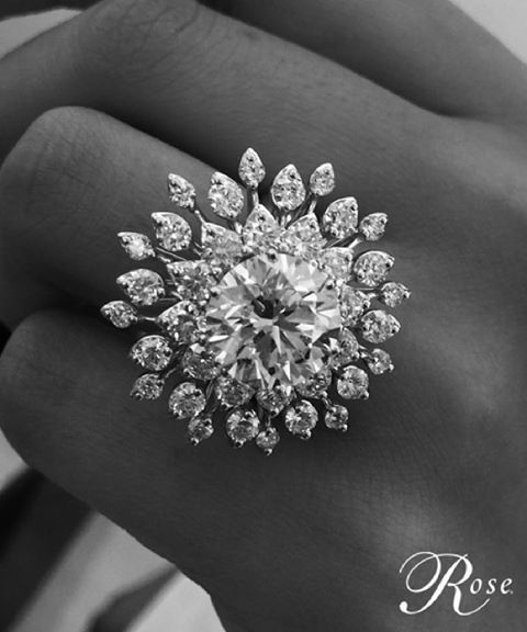 Just wow! Brilliant-cut 5-carat Diamond Solitaire nestled in a plethora of Diamond petals, set in 18K White Gold #thehouseofrose