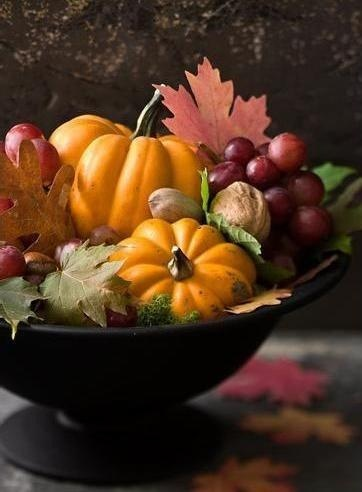 Pretty Autumn Centerpiece of Pumpkins, Grapes, Nuts and Fall Leaves.