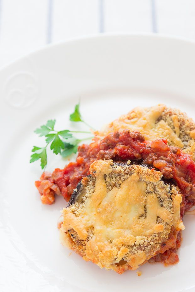 Crispy oven-fried eggplant topped with melted cheese and nestled in a bed of savory tomato sauce.