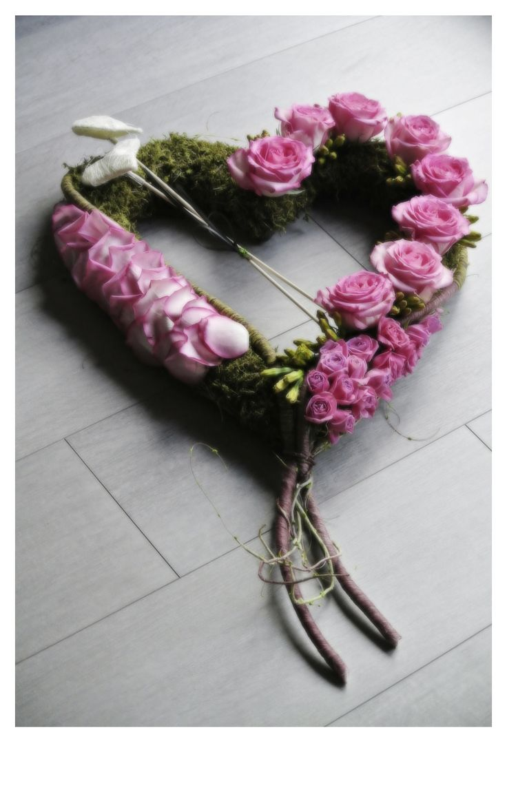 Funeral tribute with soft pink roses and rose petals