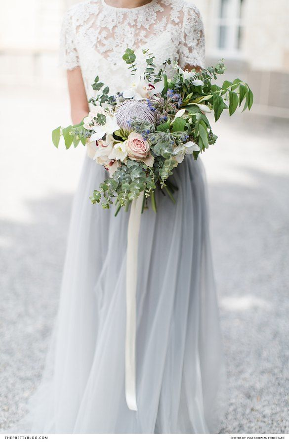 Two piece wedding dress with lace detailed top and pastel blue long skirt | Photographers: Inge Kooiman Fotografie | Planning & concept: Elsa Schaddelee | Wedding dress: Wild at Heart Bridal | Flowers: Mullers Floral Art | Hair & Make Up: The Beautiful Bride Company | Headpiece: Naturae Design