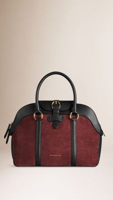 Burberry Mahogany red/black Suede and Leather Bowling Bag - A structured bowling bag in suede with grainy leather trim. Top zip closure with a protective flap referencing equestrian designs. Rolled leather handles, polished metal hardware. Discover the women's bags collection at Burberry.com