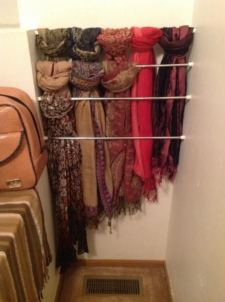 Making use of wasted space inside my closet. Easy scarf storage using several tension rods.