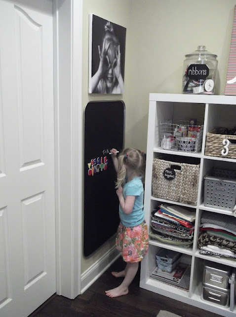 Drip pan spray painted with chalkboard paint.  Use 3m stick pads for the wall.  Good stuff!