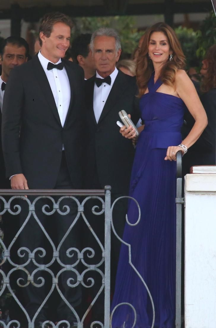 Business partner and close pal Rande Gerber arrives with wife Cindy Crawford, at the wedding of George Clooney on Sept. 27, 2014.