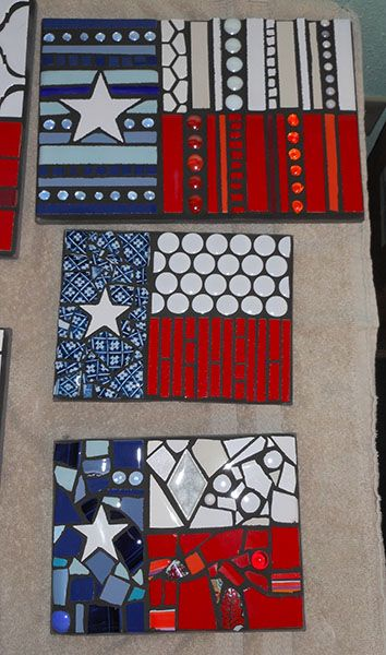 mosaic Texas flags made from scrap tiles, dishes, etc. on concrete backer board.