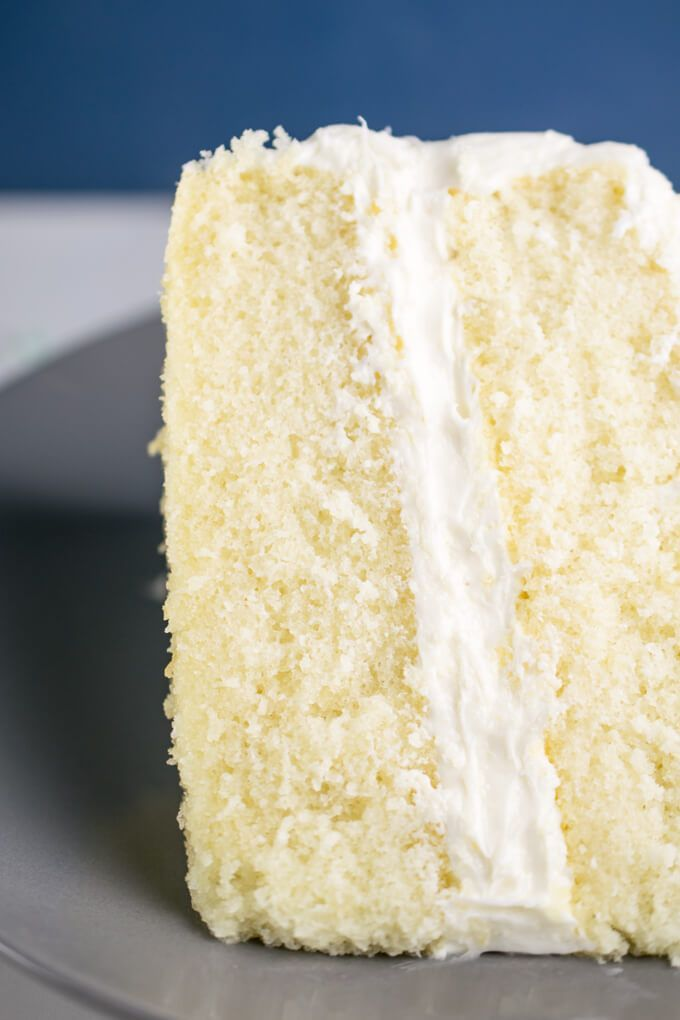 Close Up Of The Inside Of A Slice Of Vegan White Cake A Small Tender Even Crumb Is Evident With A Pale Yell Vegan Cake Vegan Vanilla Cake Vegan Yellow Cake