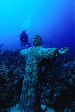 Statue of Christ, Ambergris Caye, Belize. Ambergris Caye, is the largest island of Belize located northeast of the country in the Caribbean Sea.