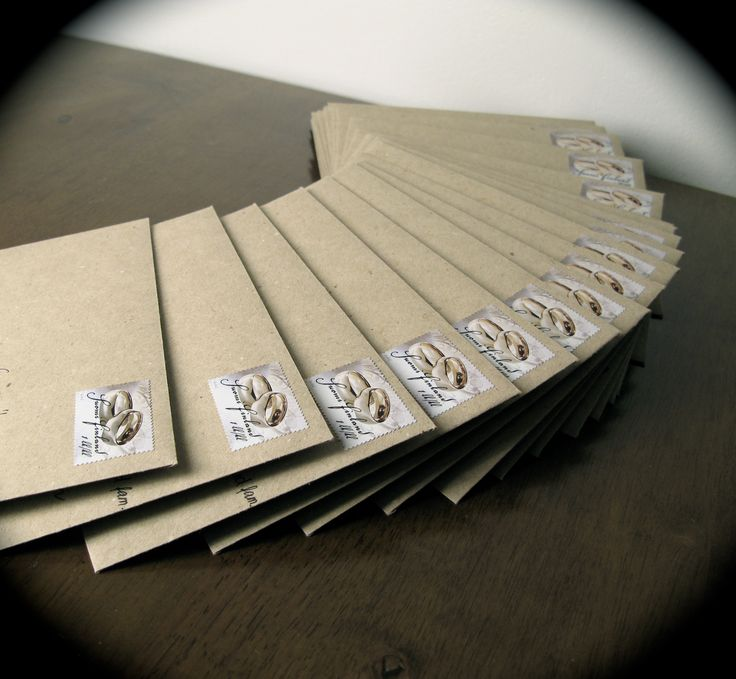 Rustic envelopes and stamps for wedding invitations.