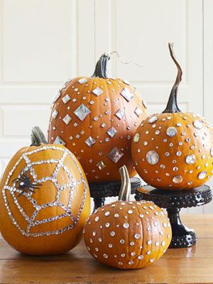 These blinged-out pumpkins are studded with self-adhesive crafts store jewels. #halloween
