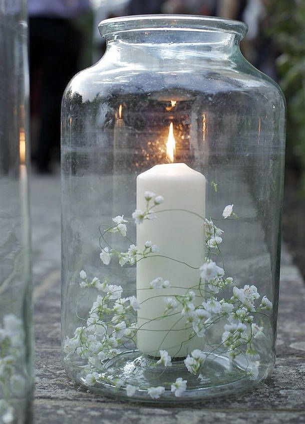 <3 - Candle and pretty little delicate white flowers - beautiful and simple wedding decoration