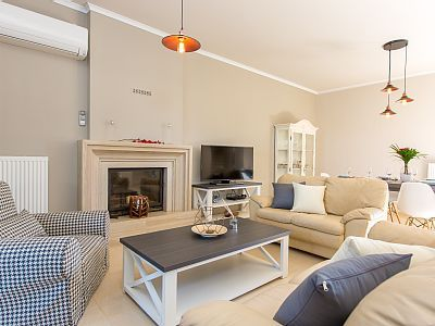 Rethymno villa rental - Comfortable living room area with a 42' smart TV, DVD player & an open firepla