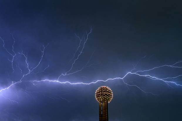 Lightning streaked across the sky behind Reunion Tower in Dallas