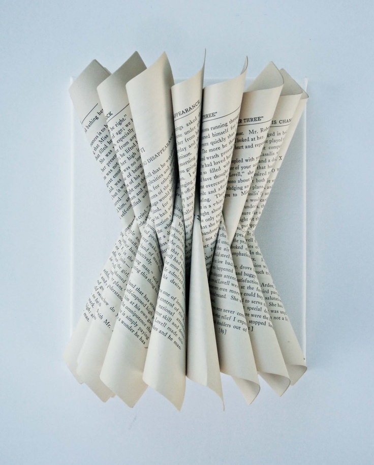 Folded Paper Book Sculpture. $30.00, via yinsteadofi on Etsy.