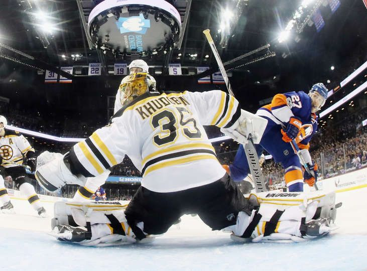 NEW YORK, NY - MARCH 25: Anton Khudobin #35 of the Boston Bruins tends net against Anders Lee #27 of the New York Islanders at the Barclays Center on March 25, 2017 in the Brooklyn borough of New York City. The Bruins defeated the Islanders 2-1. (Photo by Bruce Bennett/Getty Images)