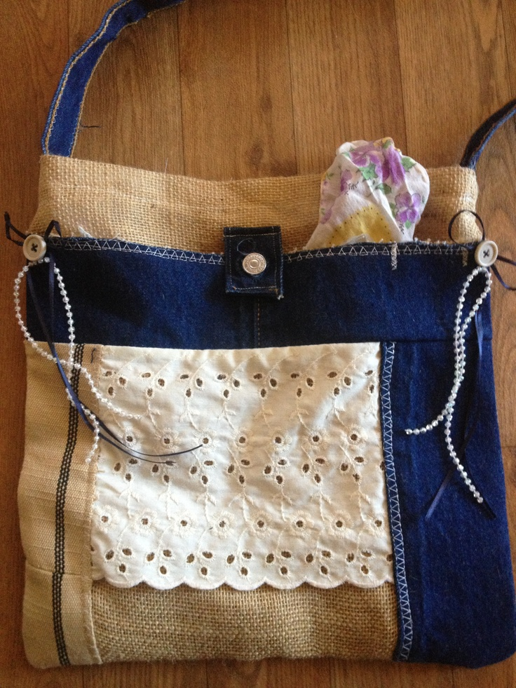 Burlap and denim bag featuring a large front pocket and matching ribbon