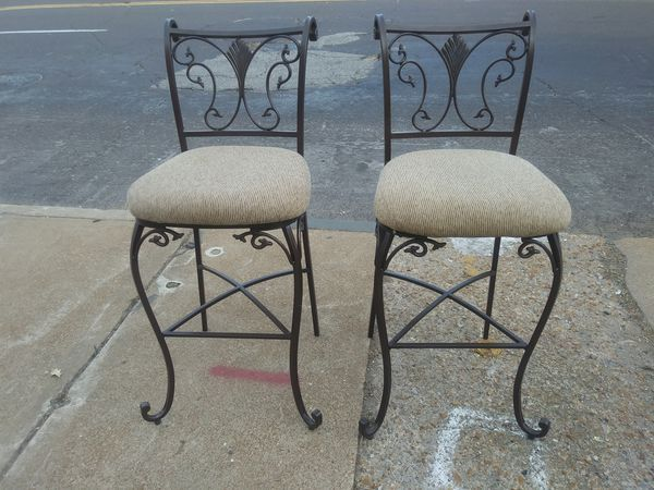 Great pair of heavy duty iron barstools that match for sale Excellent condition tall stools are soft and comfy. From Ashley Furniture. Measures 32 inches tall at seat Pickup this pair downtown near the Lumiere casino for $65. Add $30 for local delivery.