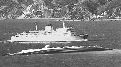 WAHINE 1966 - The New Zealand Maritime Record - NZNMM/The Picton ferry Aranui passing the wreck.