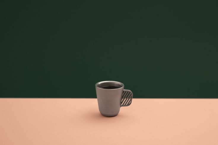 NERO / by Grynasz Studio / 2016 / An espresso cup inspired by the Italian brewing tradition, where coffee is served in a heated vessel. Both the form and the material help to keep the cup warm for an extended period. The cup was 3D-printed from stainless steel using the Selective Laser Sintering technology.