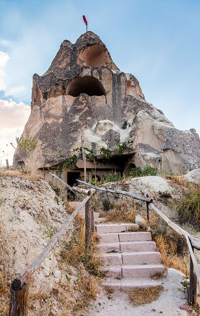 A Goreme local enjoys the use of an ancient cave home  The area is famous272 best underground  cave homes  etc images on Pinterest  . Underground Cave Home. Home Design Ideas