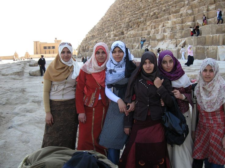 In front of the pyramids--girls love having their picture taken.