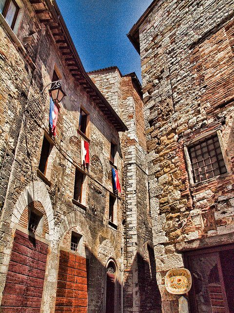 Old buildings in the medieval town of Gubbio, Italy by Anguskirk