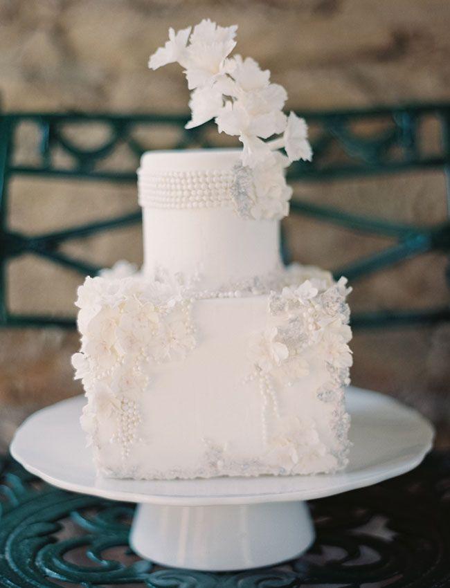 all white wedding cake by Maggie Austin