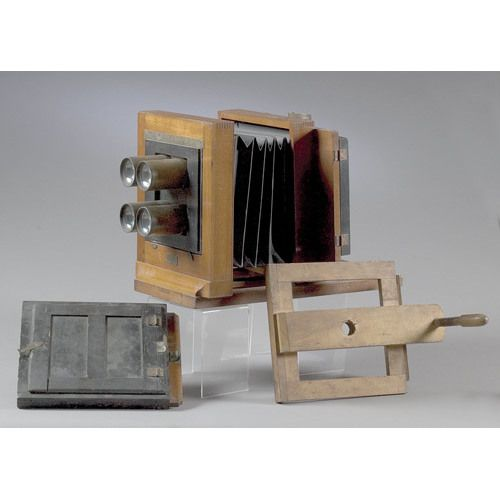 """marked with brass plate on front as above with address 591 Broadway/New York; dovetailed mahogany case with black cloth covered paper accordion bellow with four 2"""" brass mounted lenses marked B.F. & Co./3; with wooden plate holder and wood plate for top of..."""