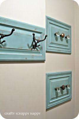 Use cabinet doors as towel hanger in bathroom instead of a towel bar