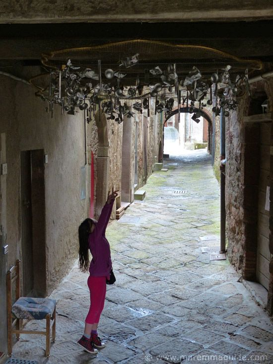 The summer outdoor art event of the Mostra La Rocca in the hill town of Roccatederighi in Maremma Tuscany